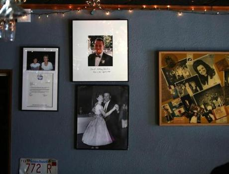 Pictures of the parents and brother of Johnny D's owner Carla DeLellis adorn a wall of the club.